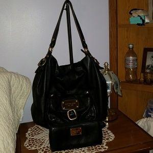 Black Michael Kors purse and matching wallet